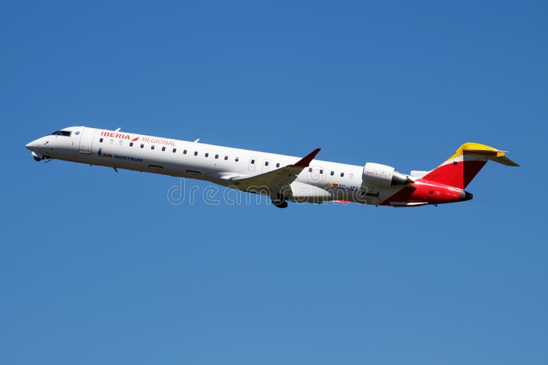 Iberia Regional Air Nostrum CRJ-900 EC-JZT passenger plane departure at Madrid Barajas Airport. MADRID / SPAIN - MAY 1, 2016: Iberia Regional Air Nostrum CRJ-900 royalty free stock photography