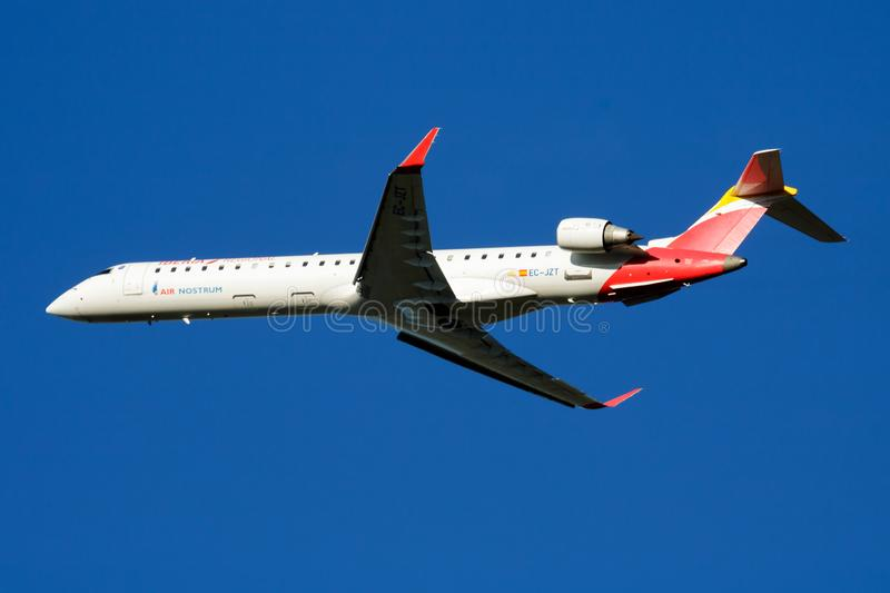 Iberia Regional Air Nostrum CRJ-900 EC-JZT passenger plane departure at Madrid Barajas Airport. MADRID / SPAIN - MAY 1, 2016: Iberia Regional Air Nostrum CRJ-900 stock images