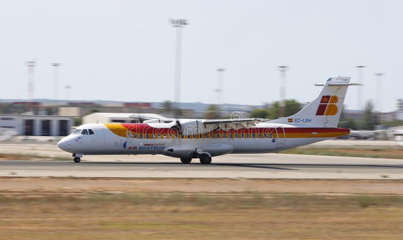 Iberia regional airliner landing in mallorca airport. An Iberia regional ATR-72 airliner lands at Palma de Majorca airport one of main Spanish airports in amount royalty free stock photos