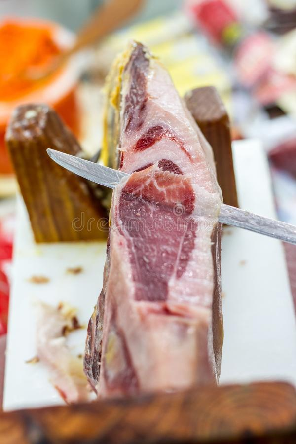 Ham iberico cut from the leg royalty free stock photo
