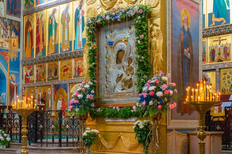 Iberian icon of the Mother of God. The Valdai Iversky Svyatoozersky Bogoroditsky Monastery. The interior of the Iberian cathedral and the Iberian icon of the stock photos