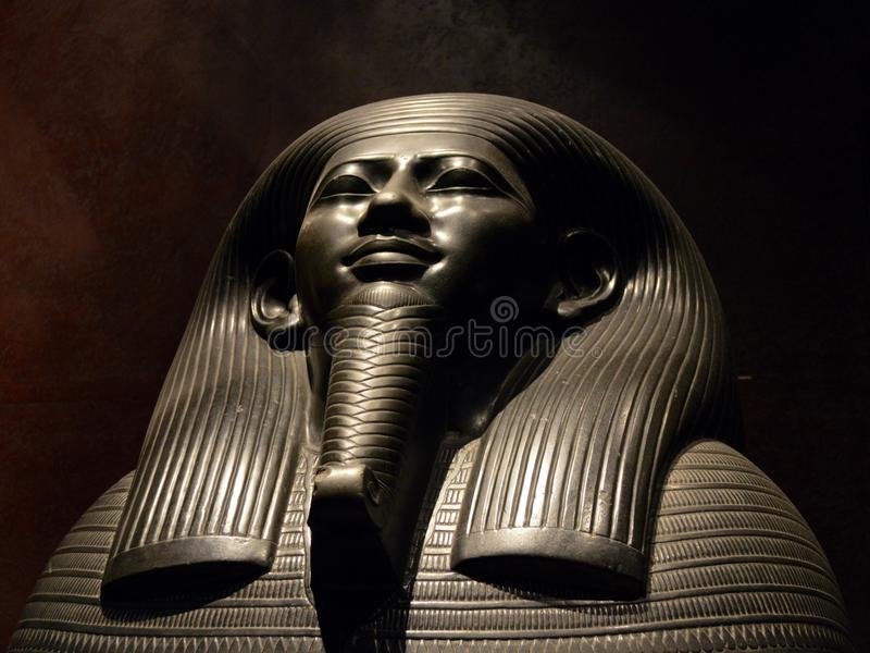 Ibi God's Wife of Amun. Detail of the Ibi God's Wife of Amun black stone sarcophagus, there is part of the collection of Egyptian Museum in Turin, Italy. The God royalty free stock photos