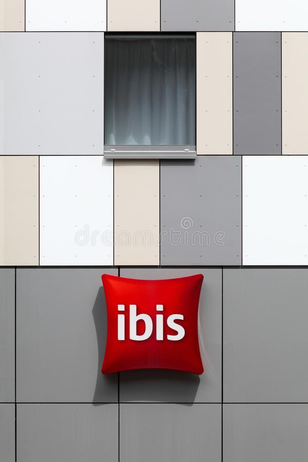 Ibis hotel sign on a wall stock photo
