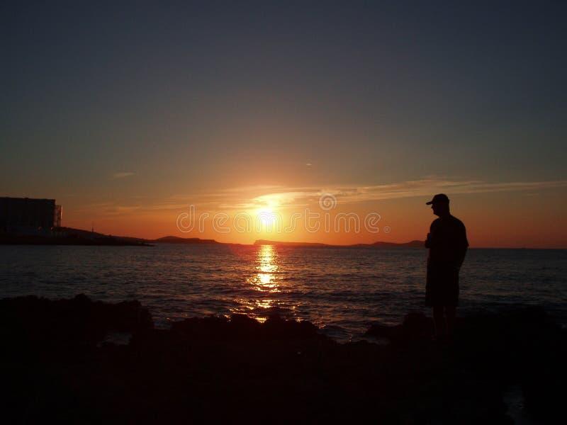 Ibiza - contemplación de la puesta del sol fotos de archivo