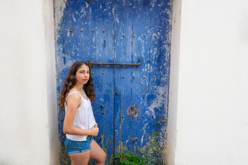 Ibiza Eivissa young girl on blue door royalty free stock images
