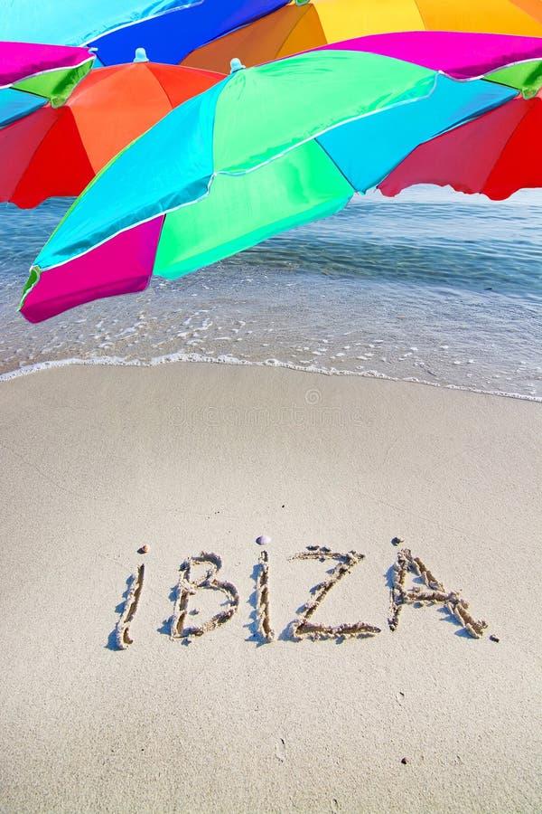 Ibiza escrito na areia imagens de stock