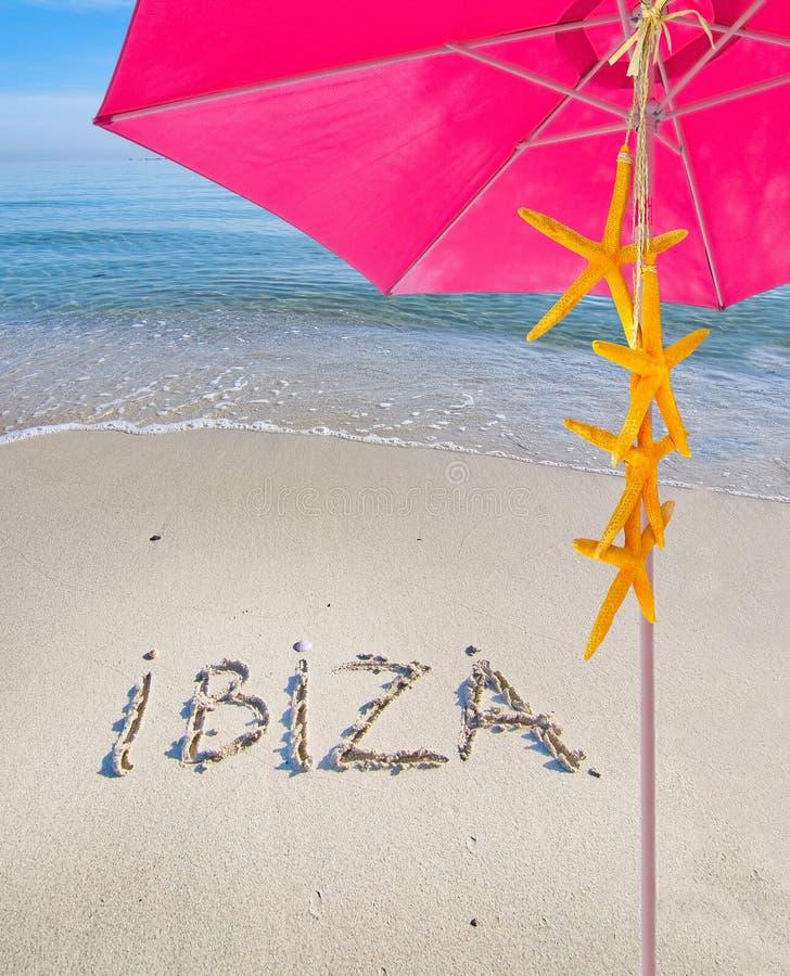 Ibiza escrito na areia imagens de stock royalty free
