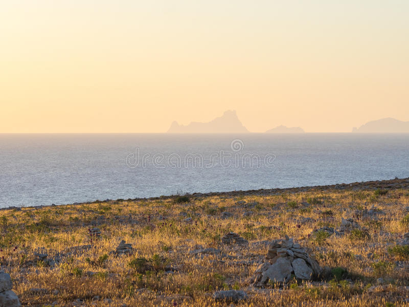 Ibiza from Formentera. View of Es Vedra, Es Vedranell and Ibiza islands from the Barbaria cape in Formentera royalty free stock image
