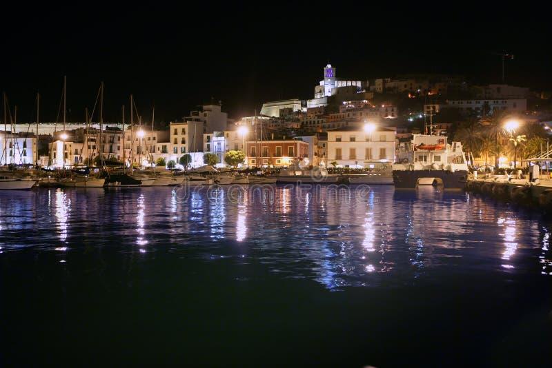 Ibiza island harbor and city under night light royalty free stock images