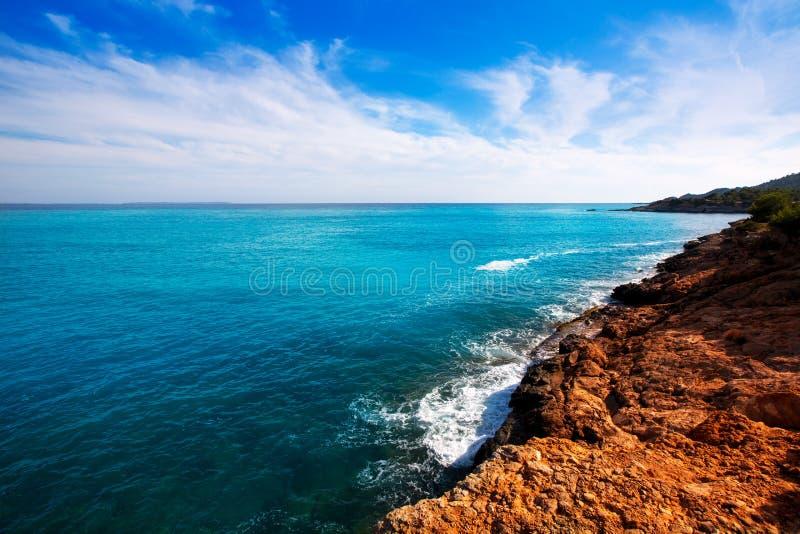 Ibiza Platja des Codolar and Cap des Falco at Balearics royalty free stock image