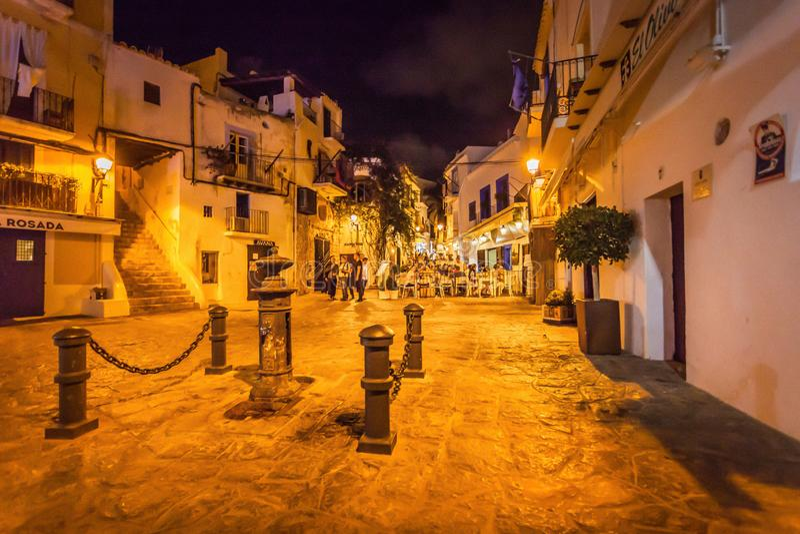 Historical streets of Ibiza Port d`Eivissa at night, city life, pubs and gardens. IBIZA, SPAIN - OCTOBER 10; 2014: Historical streets of Ibiza Port d`Eivissa at royalty free stock photos