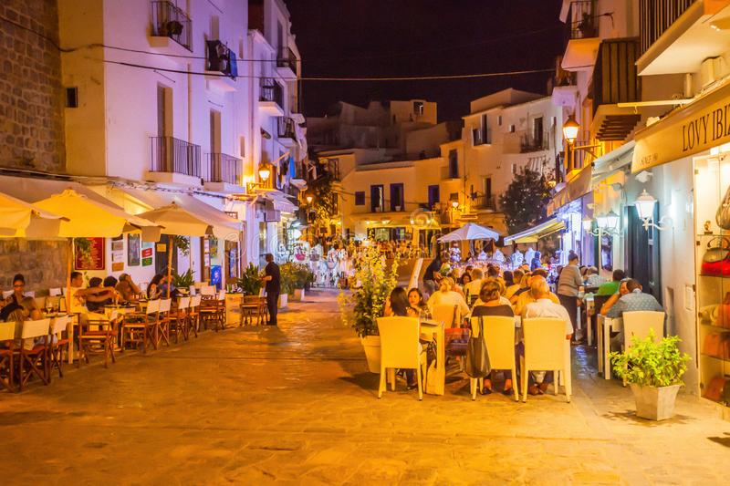 Historical streets of Ibiza Port d`Eivissa at night, city life, pubs and gardens. IBIZA, SPAIN - OCTOBER 10; 2014: Historical streets of Ibiza Port d`Eivissa at stock images