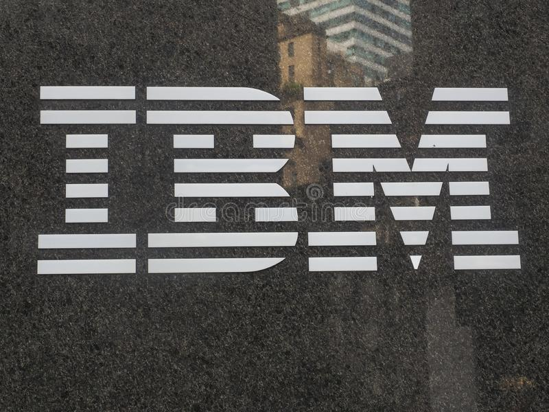 IBM logo. New York, NY, USA - July 3, 2019: IBM logo on the marble wall with Manhattan buildings reflection. International Business Machines Corporation is an royalty free stock image