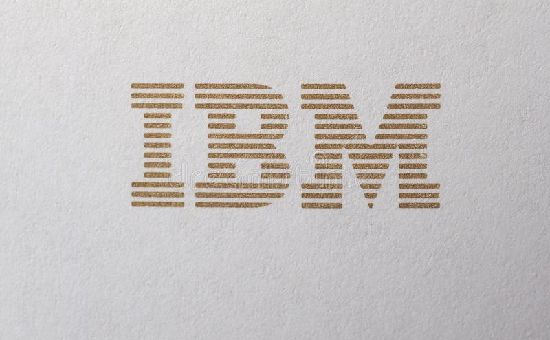 IBM logo printed on paper. NEW YORK, USA - CIRCA MAY 2016: Logo of International Business Machines Corporation, aka IBM, printed in golden ink on paper royalty free stock images