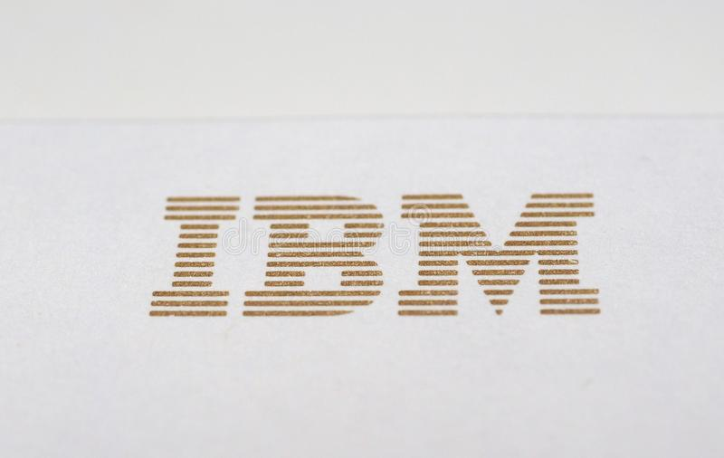 IBM logo printed on paper. NEW YORK, USA - CIRCA MAY 2016: Logo of International Business Machines Corporation, aka IBM, printed in golden ink on paper royalty free stock photos