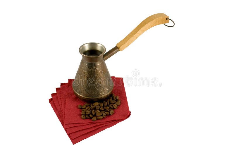 Ibrik with coffee on a serviette with coffee beans stock photography