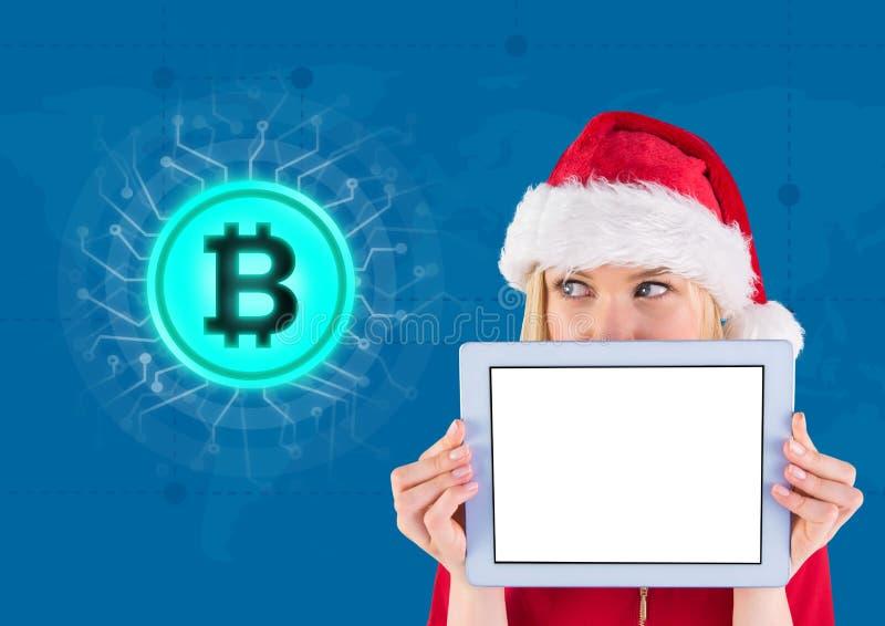 Icône et femelle Santa de Bitcoin tenant le comprimé photos libres de droits