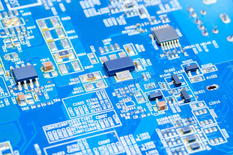 IC and electronic component on blue printed circuit board. IC component on blue printed circuit board PCB royalty free stock images