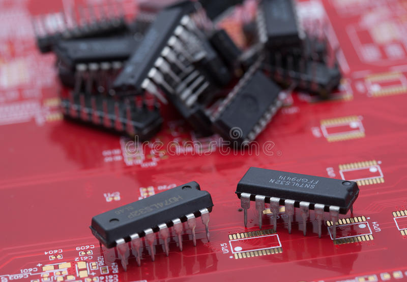 IC on red PCB.  stock images