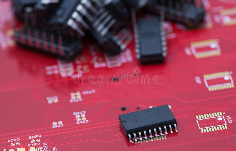 IC on red PCB.  royalty free stock photo