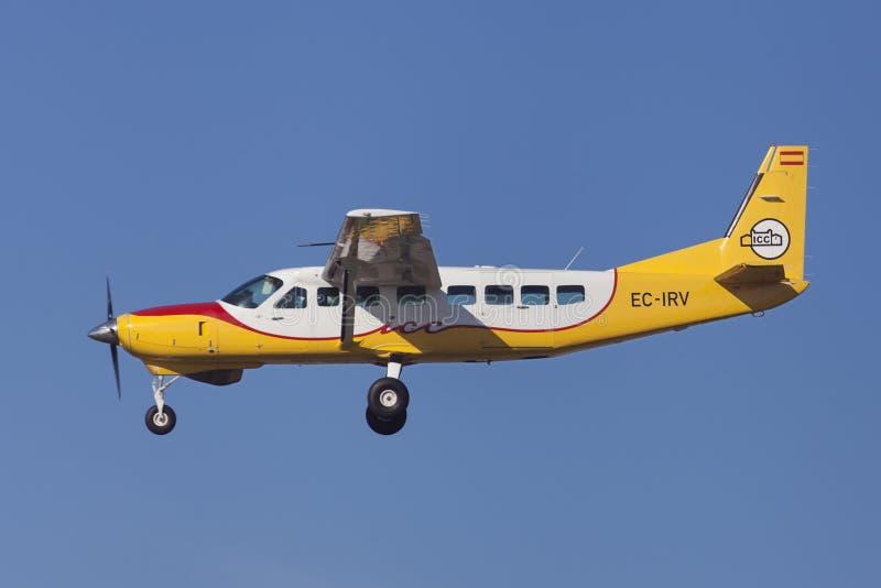 ICC Cessna 208B tusen dollarhusvagn royaltyfria foton