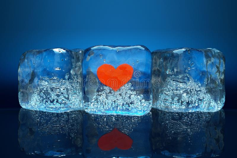 Ice. A frozen red heart as a simbol of frozen love, ice cubes with heart royalty free illustration