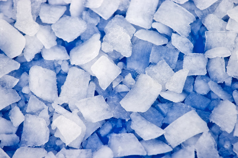 Ice. Pieces of crushed ice with blue background royalty free stock photo