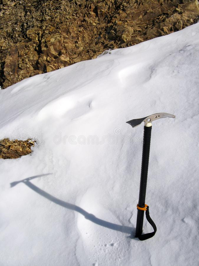 Ice axe in snow stock photography