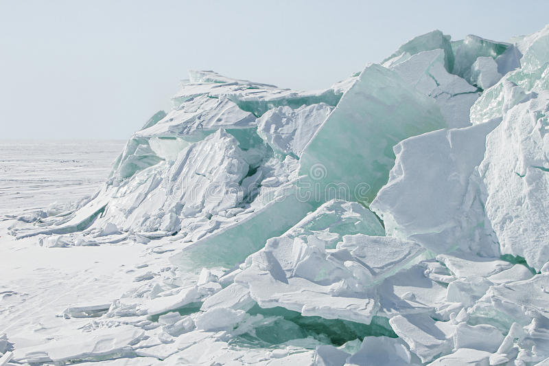 Ice background of huge blocks of aqua ice from fractured floes. royalty free stock image