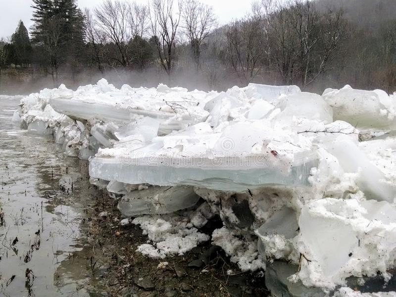Ice blocks from an ice dam. Ice blocks from the ice dam that broke in the Beaverkill River stock image