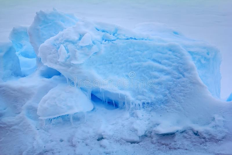 Part of toros in pack ice near the North pole. Ice blue of Arctic, full blue. Part of toros in pack ice near the North pole, 2016 and icicles summer melting stock images