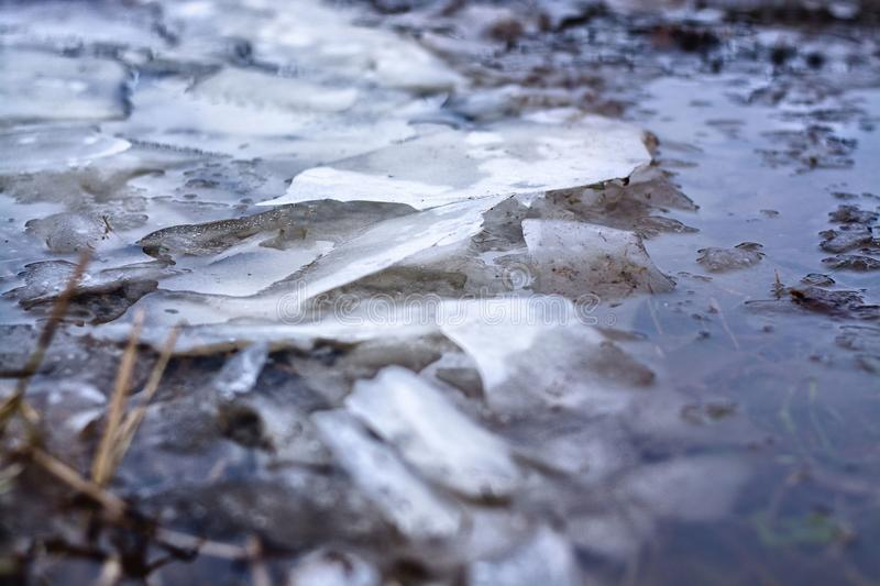 Ice broken into pieces with blue water royalty free stock photos