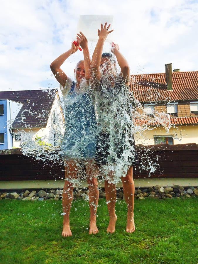 Ice bucket challenge. Tow girls making a ice bucket challenge