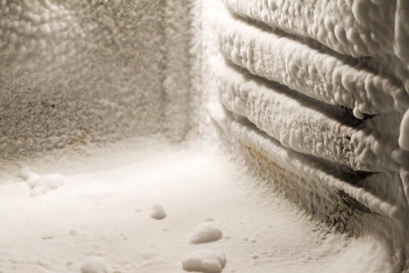 Ice buildup on freezer walls stock photo