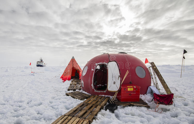 Ice camp of a polar research expedition. Polar research ice camp over a drifting ice floe in Antarctica royalty free stock image