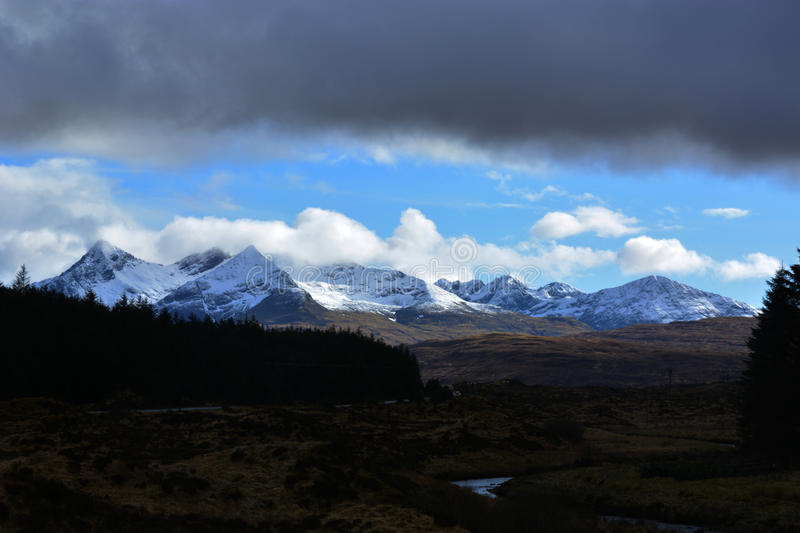 Ice-capped mountains in Scotland stock photos