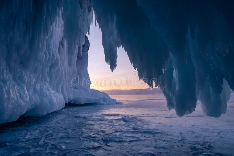 Ice cave in Baikal lake in winter season at sunset, Russia, Siberia royalty free stock photo