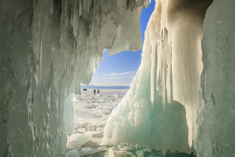 Ice Cave with icicles, winter Lake Baikal. Russia royalty free stock image