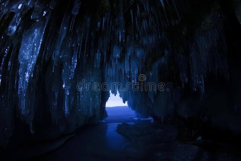 Ice cave in the moonlight at night on the island of Olkhon on Lake Baikal in winter stock image