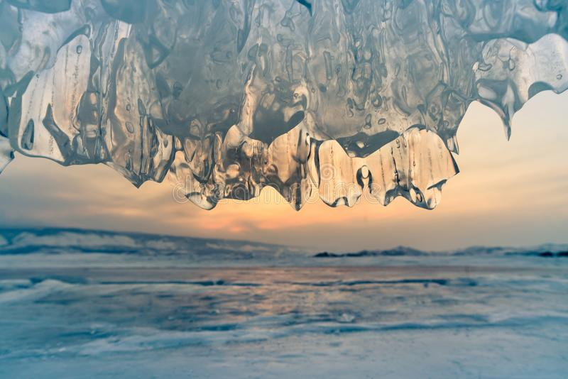 Ice cave with sunset, Baikal water lake Russia stock photos