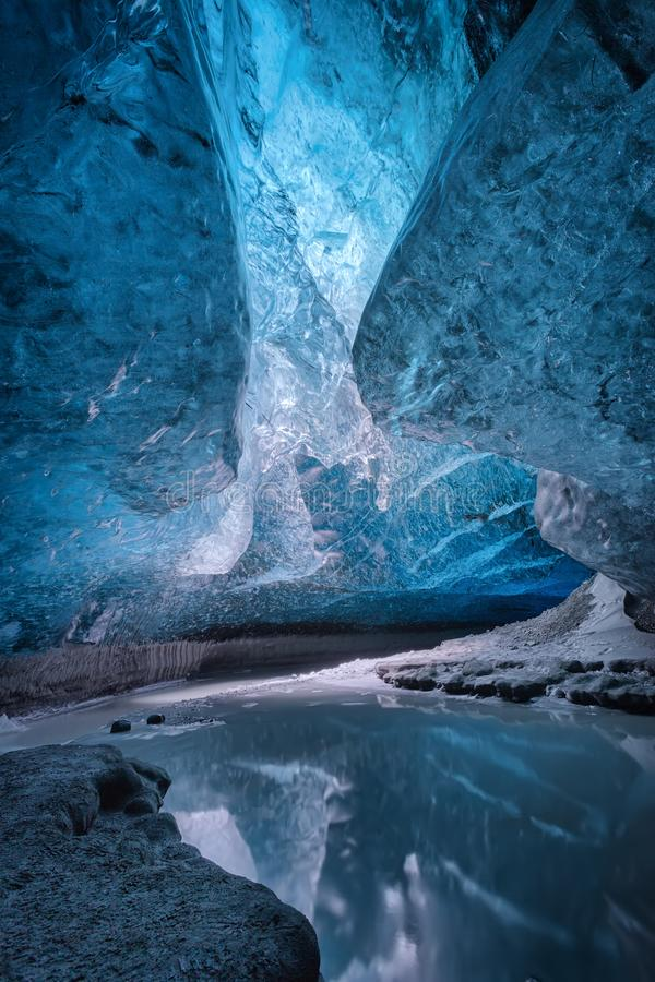 Ice cave in Vatnajokull, Iceland. Inside an ice cave in Vatnajokull, Iceland. The ice is thousands of years old and so packed it is harder than steel and royalty free stock photography