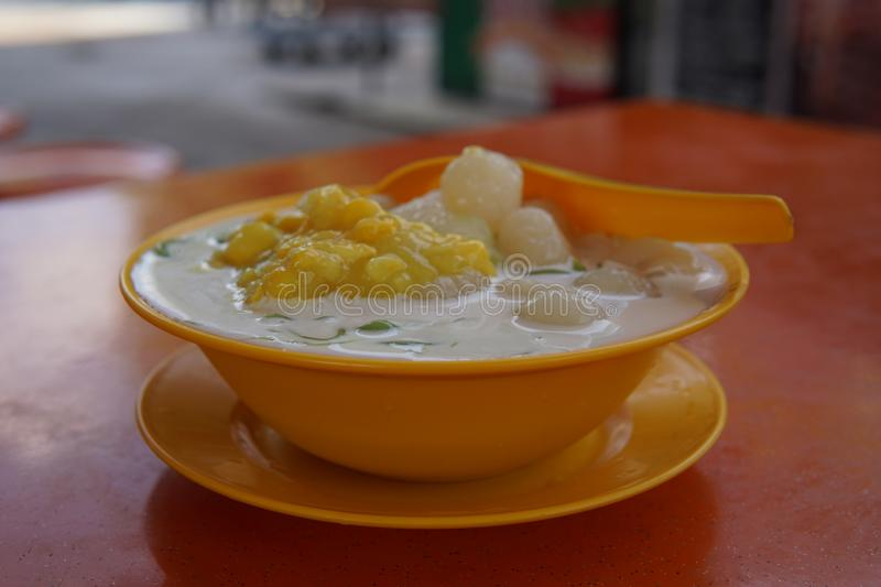 Ice cendol. Close-up of a delicious iced cendol with beans, corn and longan fruit royalty free stock photo