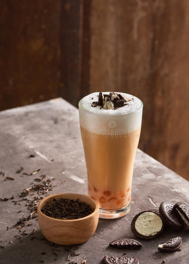 Ice cheese milk tea and bubble with chocolate cookies. stock photos