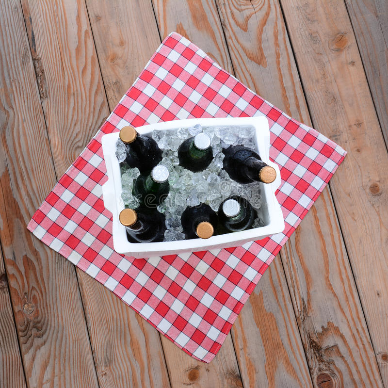 Download Ice Chest Full Of Beer On A Table Cloth On A Wood Deck Royalty Free Stock Photos - Image: 32428468