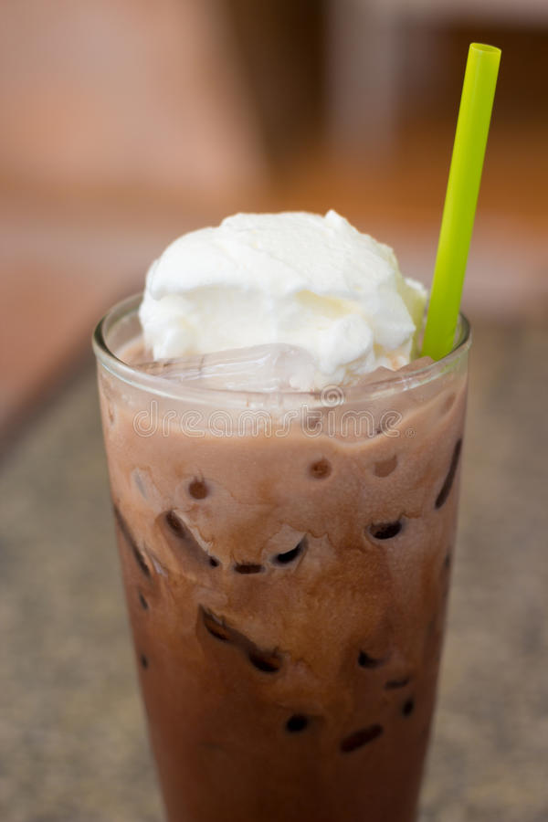 Ice chocolate with whip cream. On table royalty free stock image