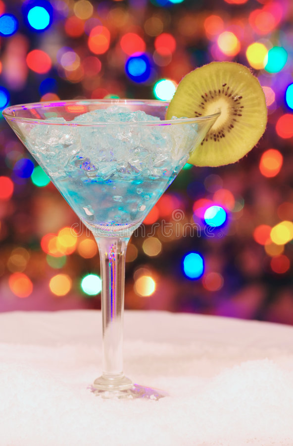 Ice christmas drink with a slice of kiwi stock images