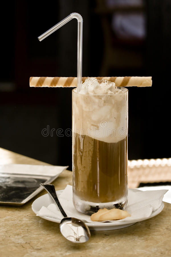 Ice coffe whith cream roll spoon stock photo