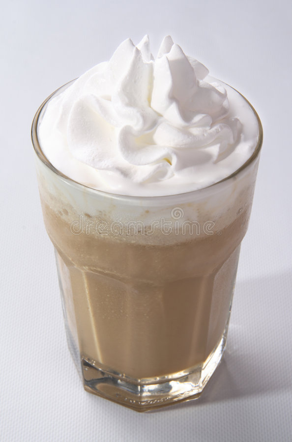 Ice Coffee. A glass of delicious cold flavored coffee with whipped cream royalty free stock photo