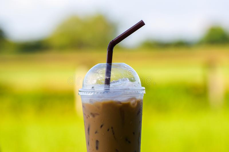 Ice coffee with blur background, Iced espresso, Cold drink in summer. Americano, beverage, black, blurred, bokeh, brew, brown, cafe, caffeine, cappuccino stock image
