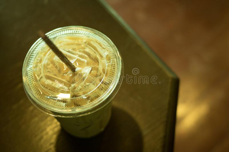 Ice coffee latte. In plastic cup on top table, color vintage style, selective focus royalty free stock photo